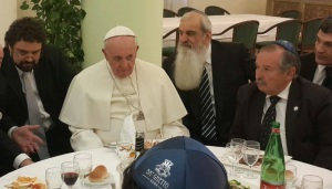 Partial eclipse of the Cross. Not sure if Francis helped the Rabbis to cook kosher.