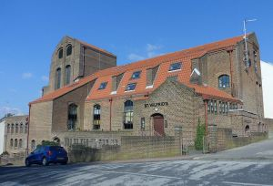 Ugly, I know; but it used to be a church. Now it hosts sheltered housing: the former St Wilfrid's church, Brighton.