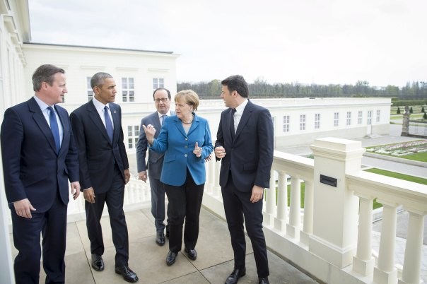 Top ranking officials chat before talks at Schloss Herrenhausen in Hanover